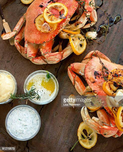 Fire roasted dungeness crabs on wooden table