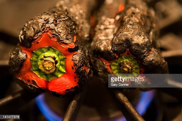 fire roasted red peppers - hob stock photos and pictures