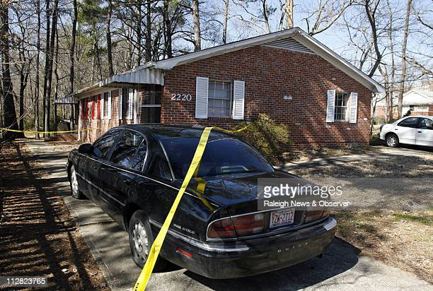 Fire scene tape extends around one section of a onestory brick duplex structure and a damaged car at 2220 Lincoln St in Durham North Carolina...
