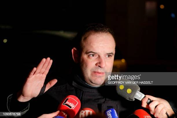 Fire service spokesman Clement Cognon speaks to the press after a building caught fire in the 16th arrondissement in Paris on February 5 2019 Seven...