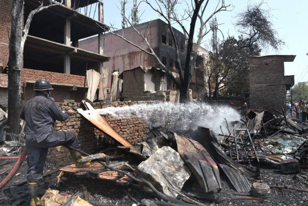 IND: Fire Breaks Out At Slum Area Near A Furniture Market In Kirti Nagar