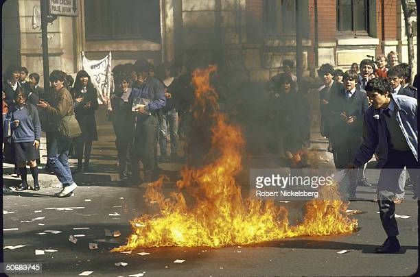 Fire set by young students at antiAugusto Pinochet government demonstration