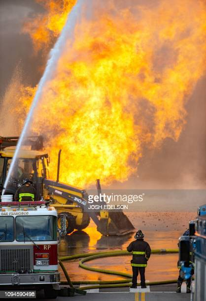 Fire shoots into the air at an intersection in San Francisco on February 6 2019 A gas line explosion in the Richmond District sent flames and smoke...