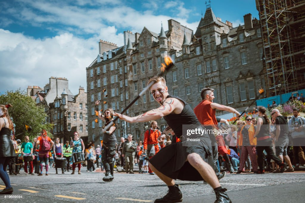 Fire Spinners Perform in an Edinburgh Street Parade : Stock Photo