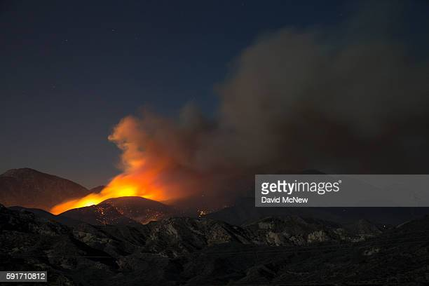 Fire spreads overnight at the Blue Cut Fire on August 17 2016 near Wrightwood California An unknown number of homes and businesses have burned and...