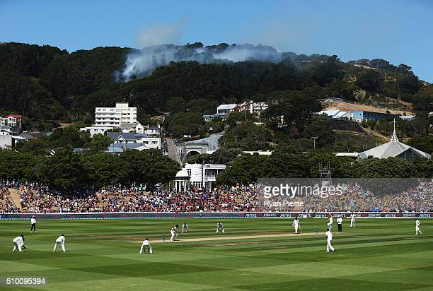 A fire starts in the hills behind the ground during day three of the Test match between New Zealand and Australia at Basin Reserve on February 14...