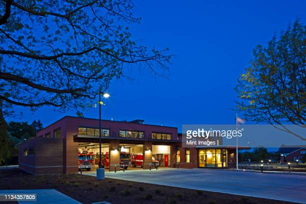 fire station at night - fire station stock pictures, royalty-free photos & images