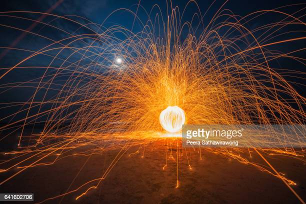 Fire steel wool with water reflection