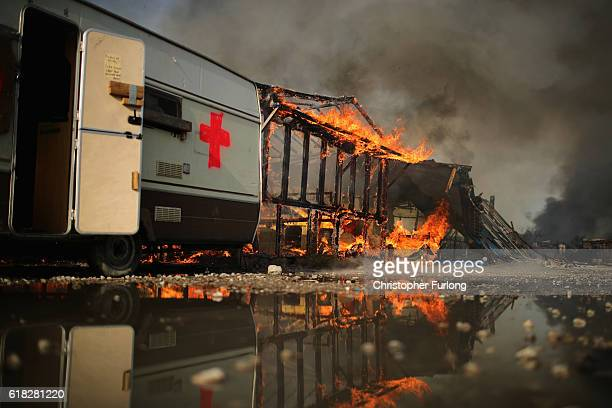 Fire takes hold in the notorious Jungle camp as migrants leave and the authorities demolish the site on October 26 2016 in Calais France Overnight...