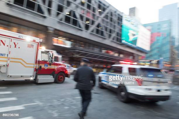 TOPSHOT A fire truck arrives after a reported explosion at the Port Authority Bus Terminal on December 11 2017 in New York New York police said...