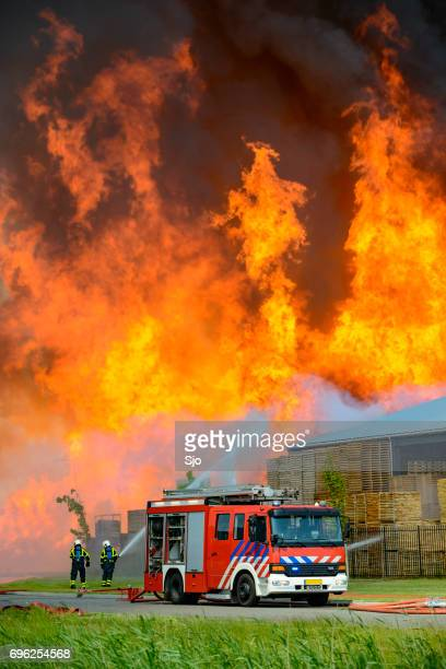 Fire truck at a large fire in an industrial area