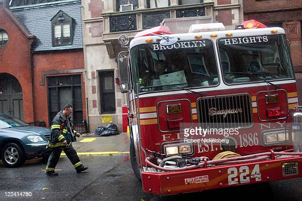 A fire truck leaves the Number 224 NYFD station in Brooklyn Heights for a reported fire in a Red Hook area school August 28 2011 in the Brooklyn...
