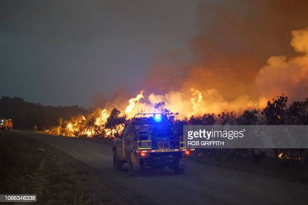 A fire truck races towards a blaze in the Deepwater National Park area of Queensland on November 29 2018 Thousands of people have been evacuated from...