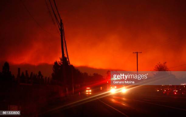 Fire truck races up Highway 12 as a fire threatens the Oakmont community in Santa Rosa on October 13, 2017. There were mandatory evacuations in the...