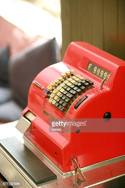 A fire truck red, vintage cash register