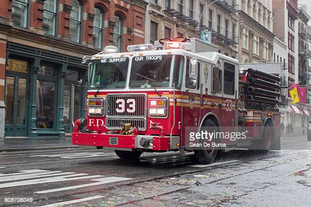 fire truck rushes down Broadway in Soho, New York