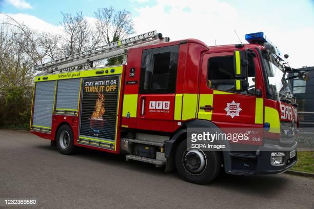 Fire truck seen parked on a roadside in London.