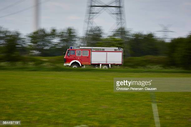 Fire Truck speeding along rural road