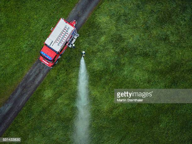 fire truck topview on lawn - fire station - fotografias e filmes do acervo