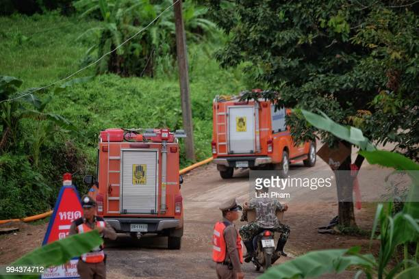 Fire trucks are seen heading to the scene at Tham Luang Nang Non cave on July 9 2018 in Chiang Rai Thailand Divers began an effort to pull the 12...