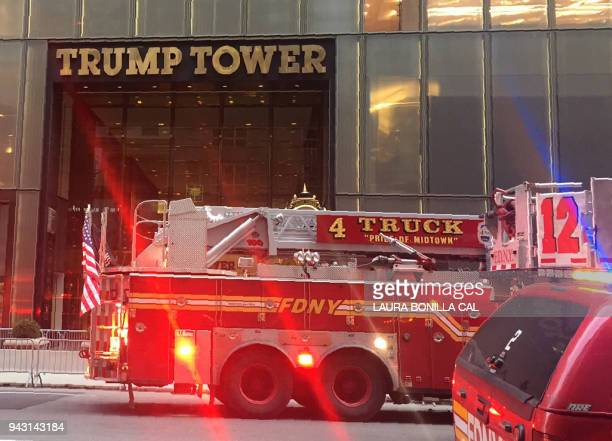 Fire trucks arrive at Trump Tower on 5th Avenue in New York on April 7 2018 during a fire on the 50th floor of the building owned by US President...