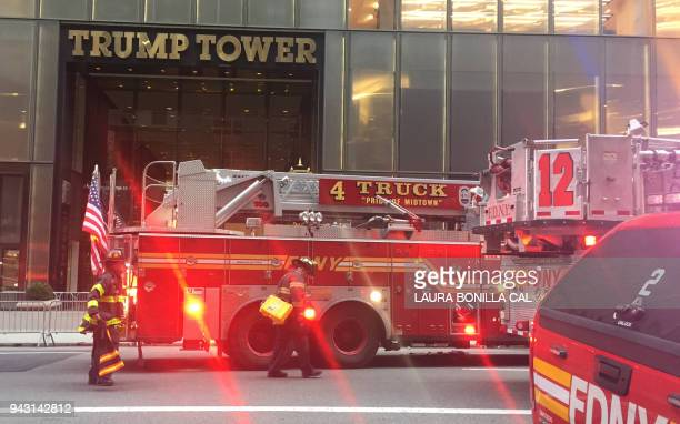 Fire trucks arrive outside Trump Tower on 5th Avenue in New York on April 7 2018 during a fire on the 50th floor of the building owned by US...
