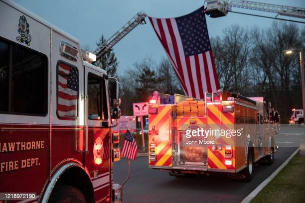 Fire trucks depart the Westchester Medical Center on April 14 2020 in Valhalla New York First responders from throughout Westchester County arrived...