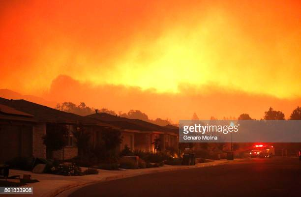 Fire trucks monitor a fire that threatens the Oakmont community along Highway 12 in Santa Rosa on October 13, 2017. The retirement community had been...