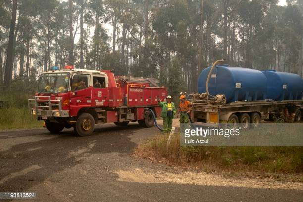 Fire trucks refills with water along the Princes Highway near Mallacoota on January 15 Australia The Princes Highway between Mallacoota and Orbost...