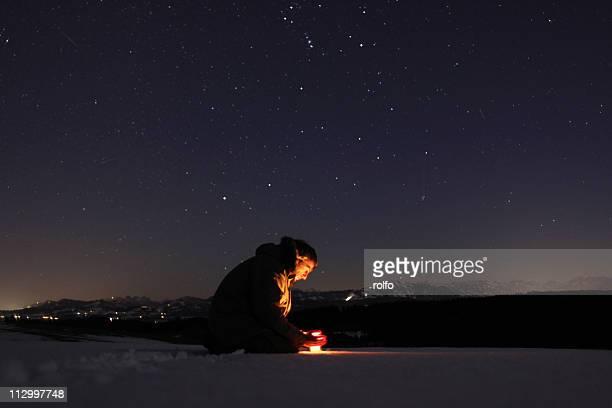 Fire under starry sky