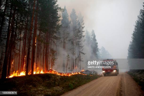 A fire vehicle is seen as fire burns in Karbole Sweden on July 15 2018 Due to the dry weather 80 wildfires burned in Sweden / Sweden OUT