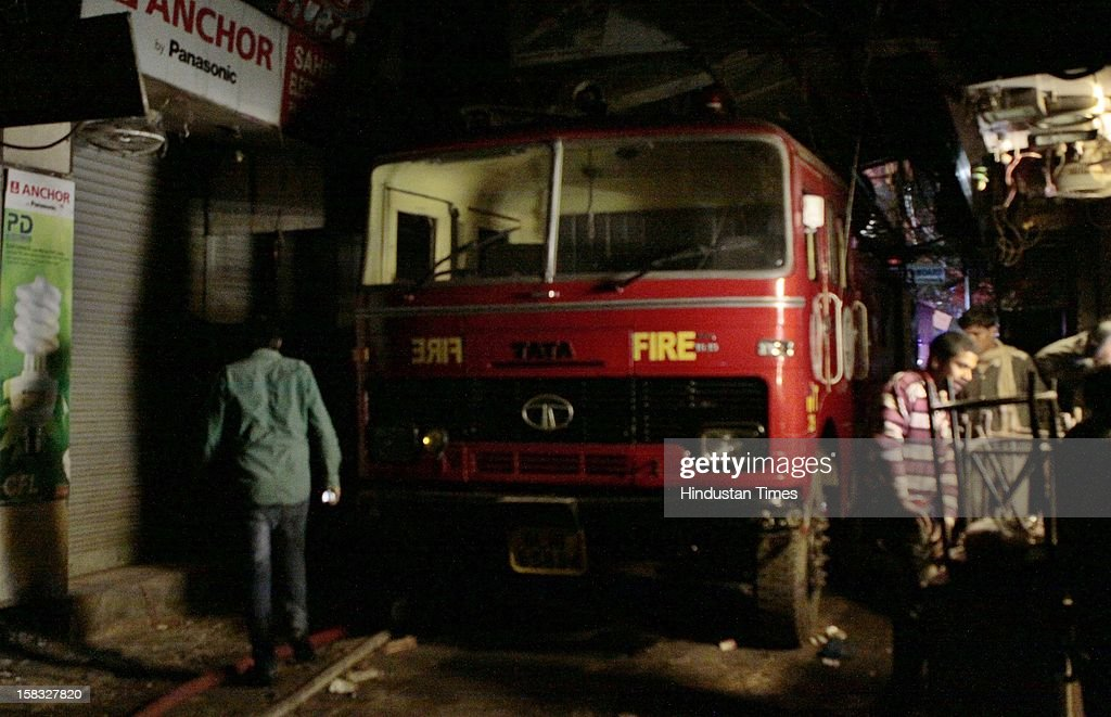 Fire vehicle stop in a narrow lane of Bhagirath Palace, an electrical market of Chandni Chowk area, on December 13, 2012 in New Delhi, India. The blaze erupted at Bhagirath Palace market at around 5.10 pm and 22 fire tenders were immediately rushed to the spot. The fire is doused with no casualties reported.