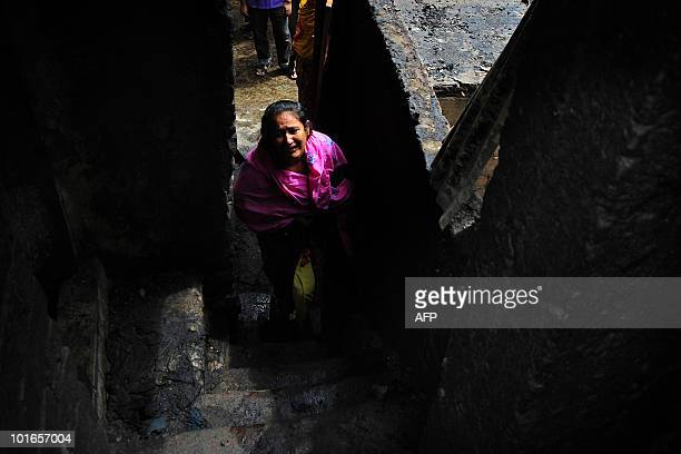 Fire victim Shahnaz returns to the destroyed family home where six family members died in an extensive fire three days prior in Old Dhaka on June 6...