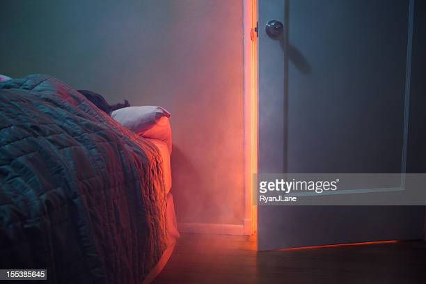 fire visible through bedroom door - fire natural phenomenon stock pictures, royalty-free photos & images