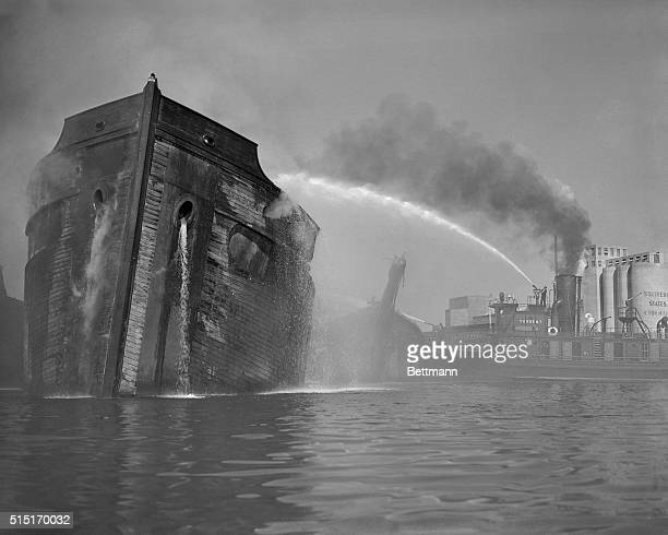 Fire which originated in the hulk of a wooden vessel laid up in a ship graveyard near Fort McHenry spread to another hulk and to the hull of another...