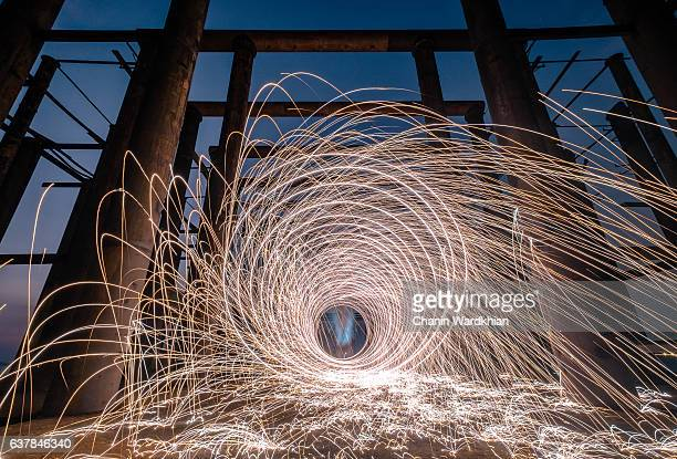 Fire Works done with Steel wool spinning, fire shower concept abstract background
