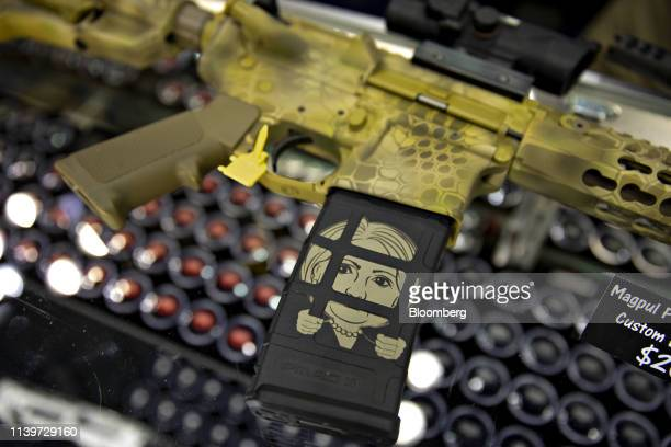 A firearm magazine featuring the image of former US Secretary of State Hillary Clinton is displayed in the San Antonio Laser Engraving booth during...
