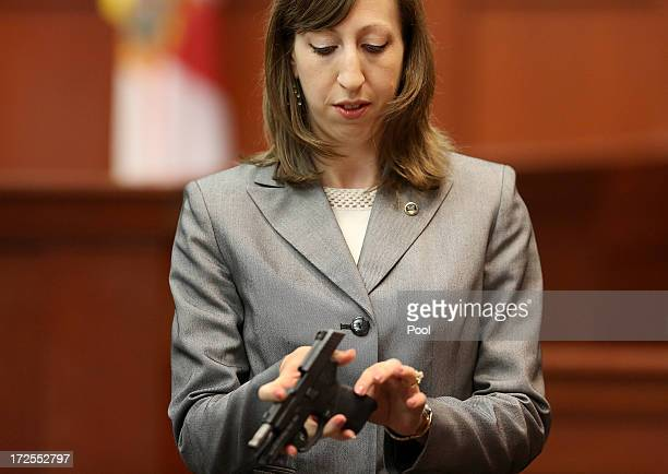 Firearms analyst Amy Siewert from Florida Department of Law Enforcement speaks to the jury while holding George Zimmerman's gun during the George...