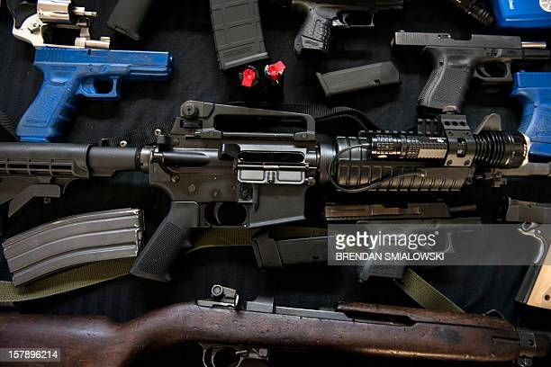 Firearms and training guns including a M1 carbine rifle and an AR15 rifle are seen in the Blevins 's garage December 5 2012 in Berryville Virginia...