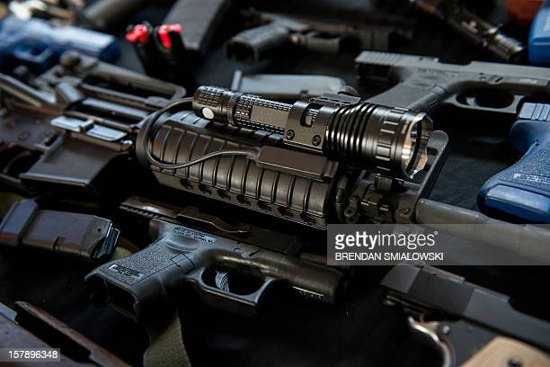Firearms and training guns including an AR15 rifle are seen in the Blevins 's garage December 5 2012 in Berryville Virginia Jay Blevins and his wife...