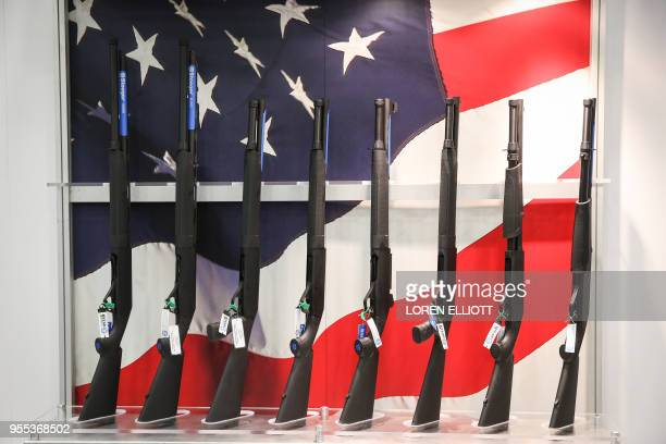 Firearms are pictured in an exhibit hall at the Kay Bailey Hutchison Convention Center during the NRA's annual convention on May 6 2018 in Dallas...