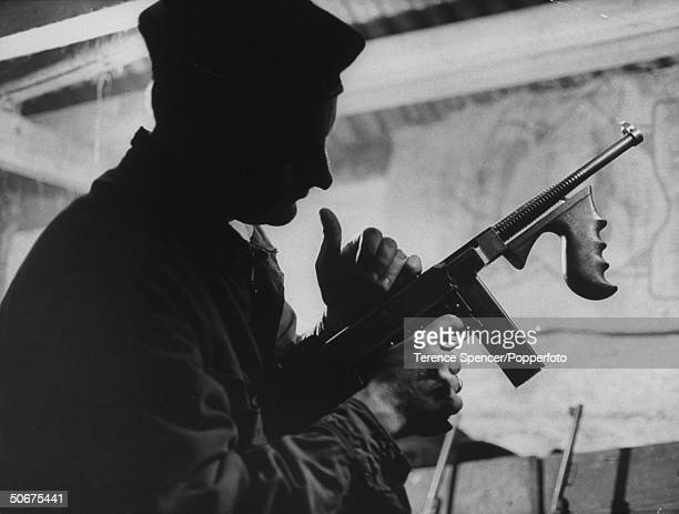 Instructor with an Thompson submachine gun at the IRA training camp