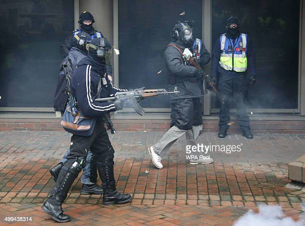 Firearms instructors play the role of terrorists during a Metropolitan Police training programme for armed officers for the eventuality of a...