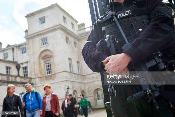 A firearms officer from the the British Metropolitan police stands guard near Horse Guards Parade in central London on April 29 2017 Police said on...