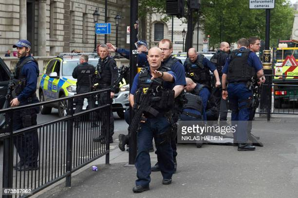 Firearms officiers from the British police detain a man later named as Khalid Mohammed Omar Ali on the ground on Whitehall near the Houses of...