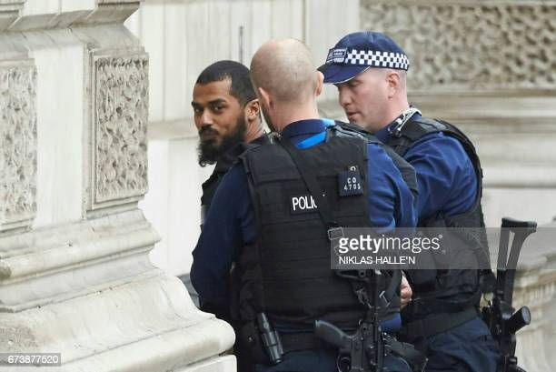 TOPSHOT Firearms officiers from the British police detain a man later named as Khalid Mohammed Omar Ali on Whitehall near the Houses of Parliament in...
