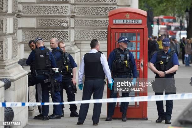 Firearms officiers from the British police detain a man later named as Khalid Mohammed Omar Ali on Whitehall near the Houses of Parliament in central...