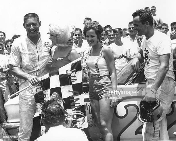 Fireball Roberts celebrates in victory lane after winning the Firecracker 400 at Daytona International Speedway The win was RobertsÕ third in the...