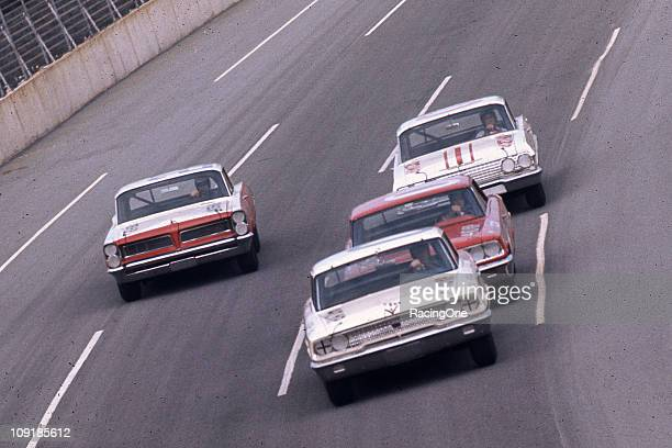Fireball Roberts in a Pontiac works the high side of a trio of cars during the Daytona 500 NASCAR Cup race at Daytona International Speedway Dan...