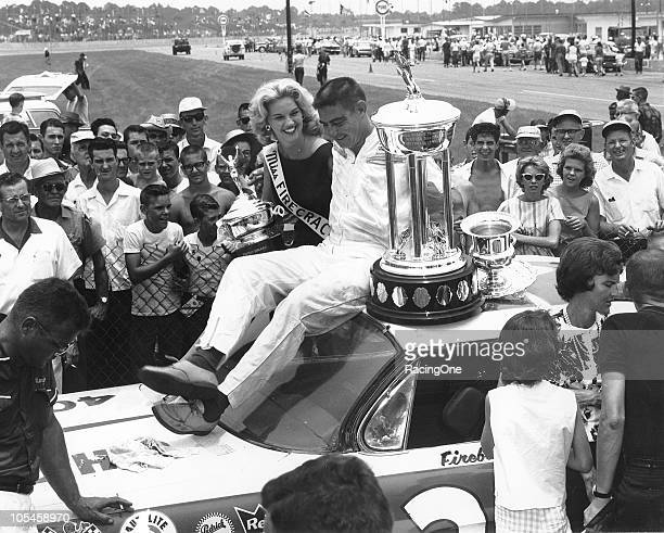 Fireball Roberts in victory lane after winning the Firecracker 250 NASCAR Cup race at Daytona International Speedway